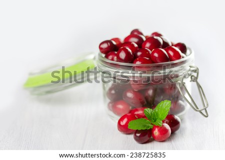 Fresh cranberries close-up.  Small depth of field  - stock photo