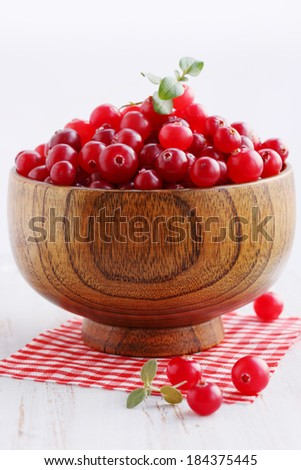 Fresh cranberries in a wooden bowl deep - stock photo