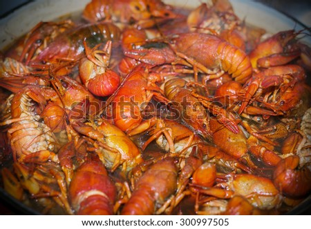 Fresh crayfish are cooked in a pot with boiling water. - stock photo