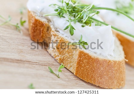 fresh cream cheese on baguette - stock photo