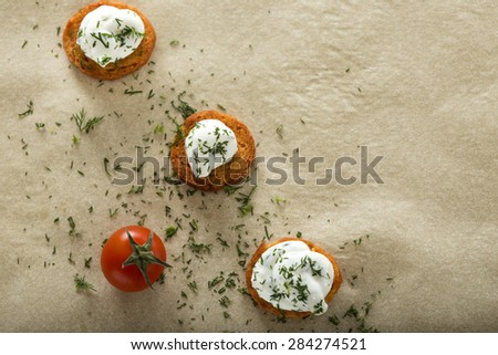 Fresh cream cheese spread with dill on bake rolls and cherry tomato with copy space - stock photo