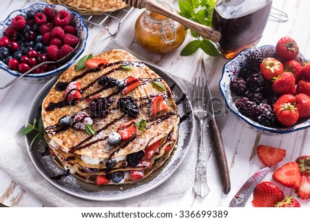 Fresh crepes with fruits and chocolate, from above - stock photo
