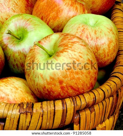 Fresh crisp apples in a basket.  Close up detail. - stock photo