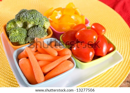 Fresh crisp vegetables arranged in individual dishes.