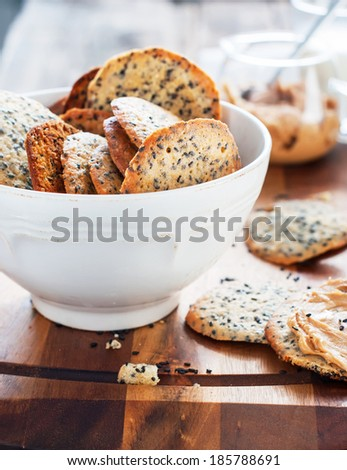 Fresh Crispy Cookies with Black Sesame Seeds in white Bowl - stock photo
