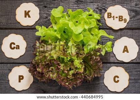Fresh crispy lettuce and Lollo Rossa. Source of vitamins A, C, group B, rich in potassium, calcium, phosphorus, magnesium. Used in dietary, health and vegetarian nutrition, detox - stock photo