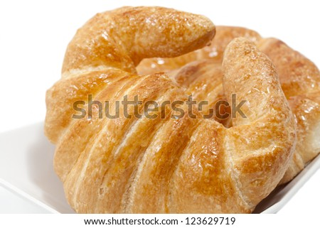 Fresh Croissant with caramelized white background