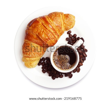 Fresh croissant with cup of hot coffee on white background - stock photo