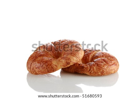 fresh croissants isolated on white