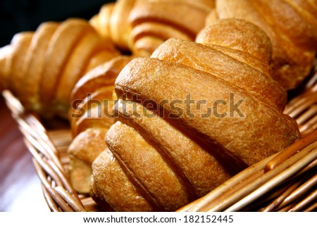 fresh croissants on wicker basket