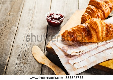 fresh croissants with jam for breakfast - stock photo