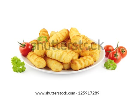Fresh croquettes on a plate decorated with tomatoes and parsley - stock photo