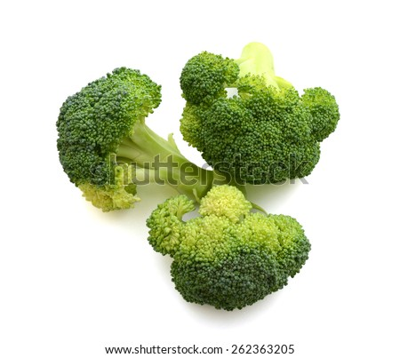 fresh crown broccoli on white background - stock photo