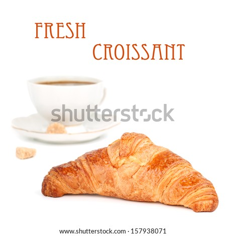 Fresh crusty croissant  and black coffee in background, isolated on white