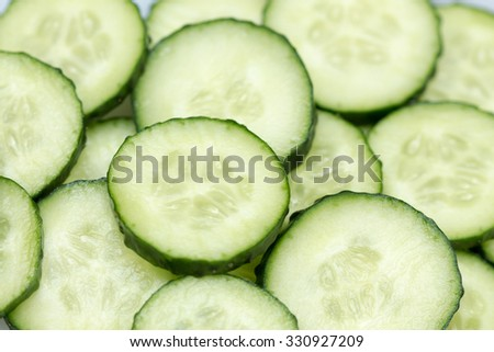 Fresh Cucumber and slices white background.  - stock photo