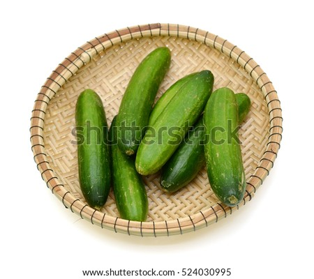 Fresh cucumber in basket isolated on white background