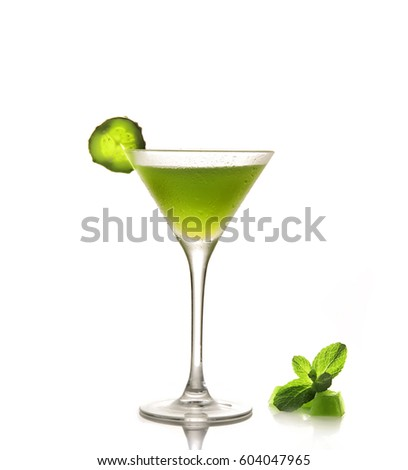 Fresh cucumber juice in a glass on a white background.Ice cubes and mint
