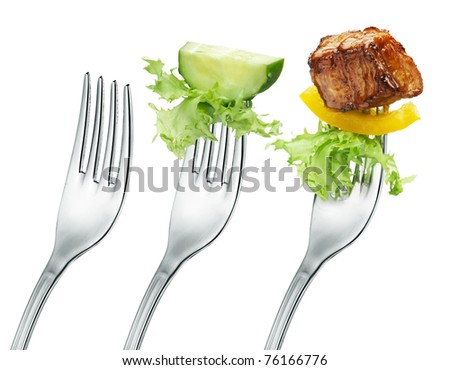 fresh cucumber, meat and salad on a fork. Isolated - stock photo