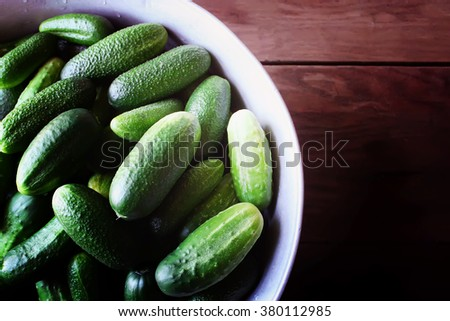 Fresh cucumbers in a basket on green grass  - stock photo