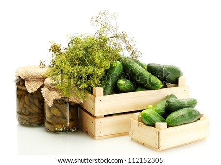 fresh cucumbers in wooden boxes, pickles and dill isolated on white - stock photo