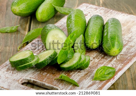 Fresh cucumbers on a wooden table. Selective focus