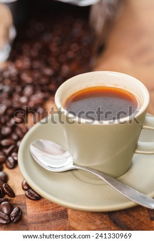 Fresh cup of Coffee and Beans - stock photo