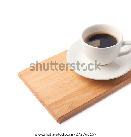 Fresh cup of coffee on a ceramic plate over the wooden serving board, composition isolated over the white background and framed as a close-up copyspace background composition - stock photo