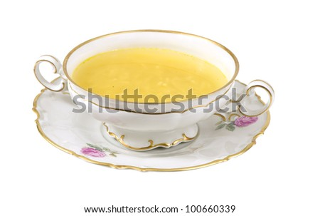 fresh cup of hot chicken broth on a white background - stock photo