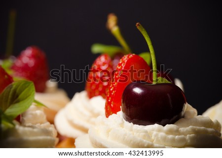 Fresh cupcakes with cream and berries. Shallow depth of field. Selective focus. Toned. - stock photo