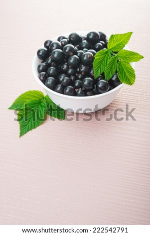 fresh currant berry on wooden background - stock photo
