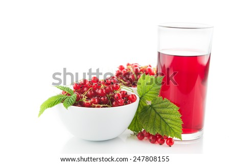 Fresh currant with green leaf in plate isolated on white. Glass of fresh juice. Healthy food background. - stock photo