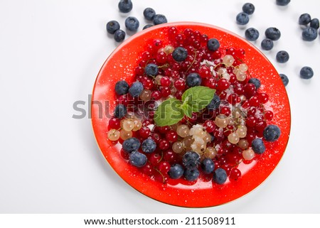 Fresh currants and blueberries - stock photo