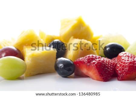 Fresh cut fruit on white background - stock photo