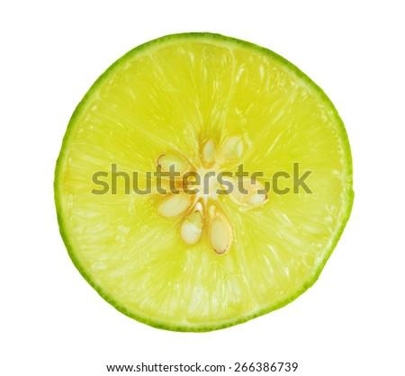 Fresh cut lime quarters - citrus fruit, isolated on white background . - stock photo