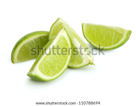 Fresh cut lime quarters - citrus fruit, isolated on white background with shadow