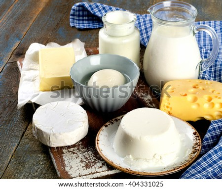 Fresh Dairy products on a wooden background - stock photo