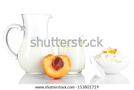 Fresh dairy products with peaches isolated on white - stock photo