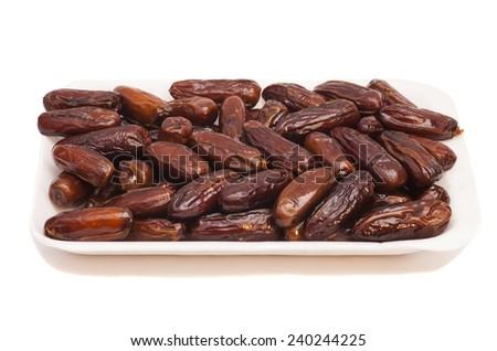 fresh dates fruits isolated on white - stock photo