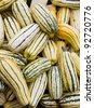 Fresh Delicata squash ready for sale at the farmers market - stock photo