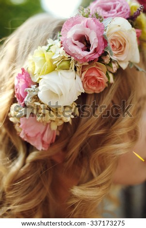 Fresh delicate magical wedding wreath white pink and yellow roses on beautiful blonde bride close-up - stock photo