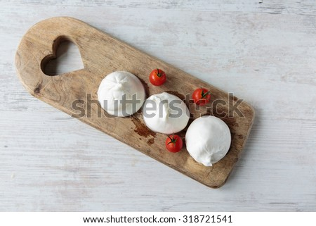 Fresh delicious burrata cheese typical from Apulia region, Italy - stock photo