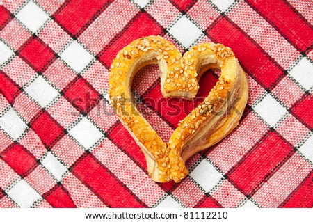 Fresh delicious cookies in a heart shaped - stock photo
