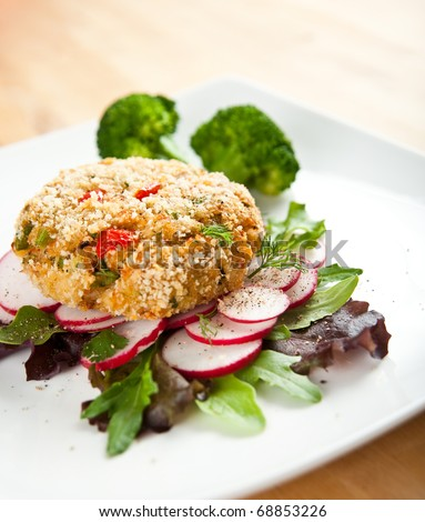 Fresh Delicious Crabcake Served with Vegetables and Spices - stock photo