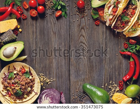 Fresh delicious mexican tacos and food ingredients. - stock photo