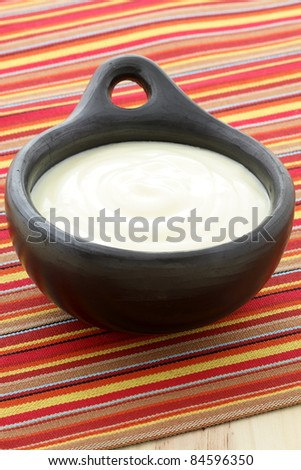 fresh delicious sour cream a traditional ingredient in France,Russia, Eastern European, German cooking and mexica cuisine. - stock photo