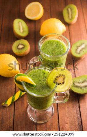 Fresh dessert kiwi cocktail on table - stock photo