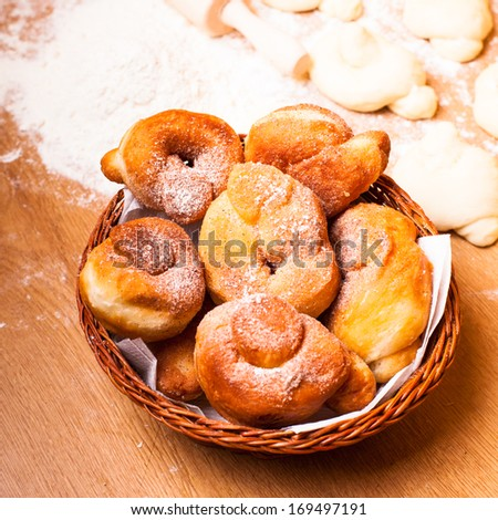 Fresh donats with sugar powder and prepared dough