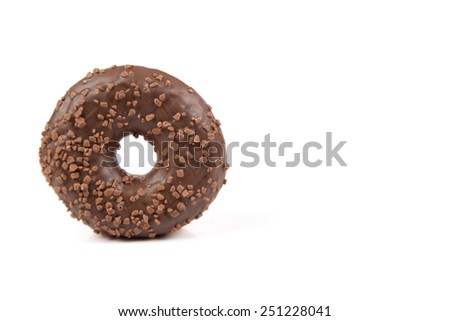 Fresh donut with chocolate and nuts isolated on white background