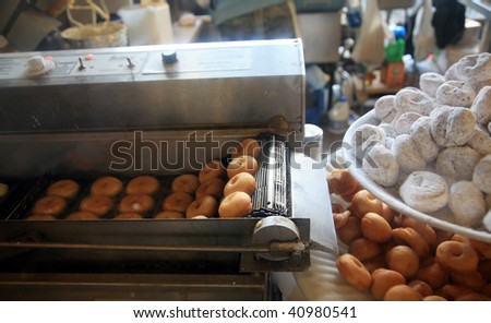 fresh donuts being made - stock photo