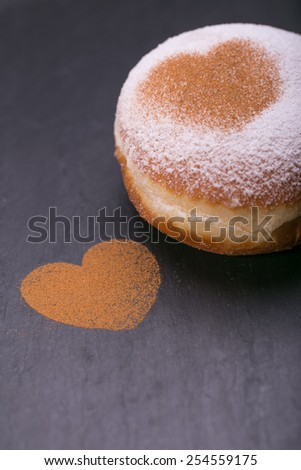 Fresh donuts.  homemade doughnuts with heart from cinnamon - stock photo